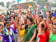 Photos: Congress Supporters And Workers Celebrate Party's Victory