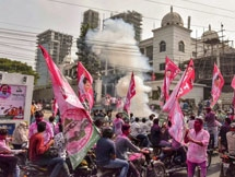 Photos: TRS Supporters And Workers Celebrate Party's Victory