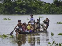 Photos: Heavy Rainfall And Floods In Assam