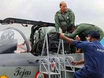 Photos: Defence Minister Rajnath Singh Flies Fighter Jet Tejas In Bengaluru
