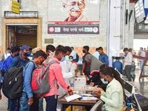 Photos: Health Worker Collects COVID-19 Test Sample In Mumbai