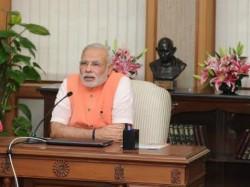 Narendra Modi Adopts Mahatma S Vision Promotes Spinning Wheel
