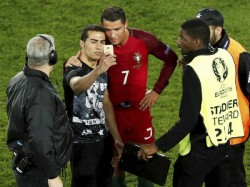 Euro 2016 Portugal S Cristiano Ronaldo Joins Pitch Invader Selfie