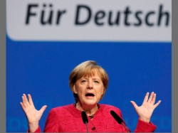 Merkel Slams Trump While Asserting Germany S Commitment Climate Accord