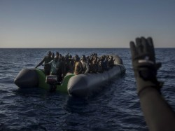 Over 97 Migrants Missing After Boat Sinks Off Libya