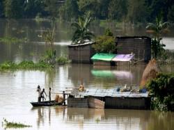Heavy Rainfall Causes Floods Tripura Boats Save Drowning Pe