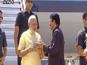 No Bouquet Only A Book For Modi On Arrival At Madurai Airport