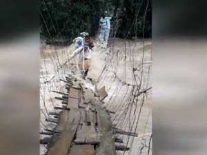 Video Two Persons Cross Bridge Over Devastating River Reminds Of Kerala Floods