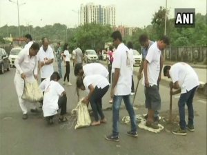 Nation salutes Mumbai man who has fixed 556 potholes after his son died in one of them
