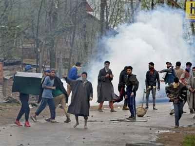 A group of youth pelting stones on security forces in Kashmir.