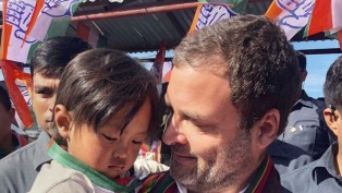 Congress President Rahul Gandhi Holds A Child During An Election Rally In Champhai