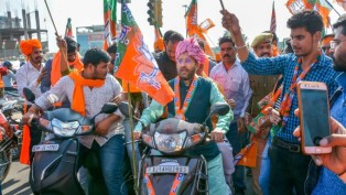 Rajasthan State Election In-Charge Prakash Javadekar Rides A Scooter During An Election Campaign