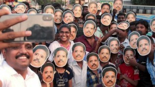 A Group Of People Wearing Su. Venkatesan Mask (CPM Candidate) Take Selfies With The Candidate