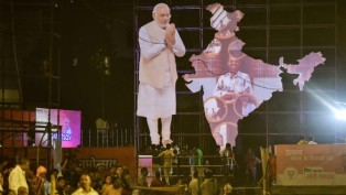 A Cutout Of PM Narendra Modi Seen At Dashashwamedh Ghat On The Eve Of PM Modi's Election Rally