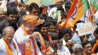 BJP National President Amit Shah Waves At Party Supporters During A Roadshow