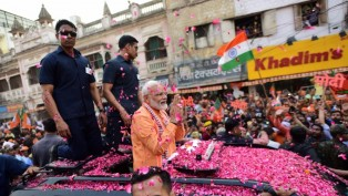 Prime Minister Narendra Modi during his roadshow, a day ahead of filing his nomination papers