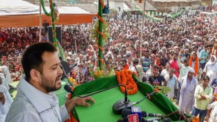 RJD leader Tejashwi Yadav addresses an elections campaign rally