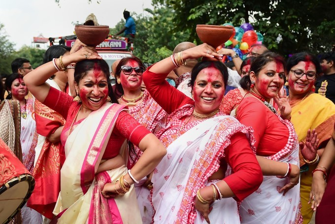 Devotees Dance As They Celebrate Vijaya Dashami (Dussehra) Before The Immersion Of An Idol Of Goddes