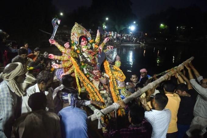 Devotees Immerse An Idol Of Goddess Durga On The Occasion Of Vijayadashami In Varanasi