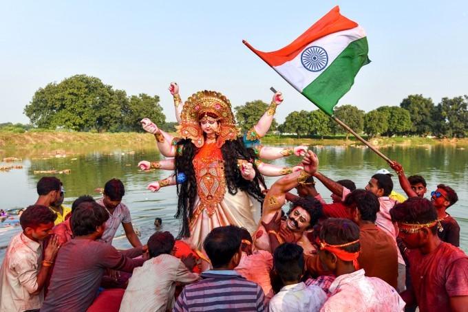 Devotees Immerse An Idol Of Goddess Durga On The Occasion Of Vijayadashami, At A Pond Near Jhusi Vil