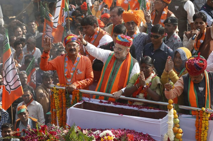 BJP President Amit Shah Waves To His Party Supporters During An Election Campaign