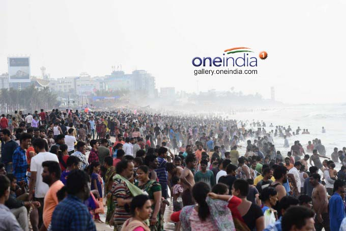 Devotees Takes Holy Dip At Vizag Beach