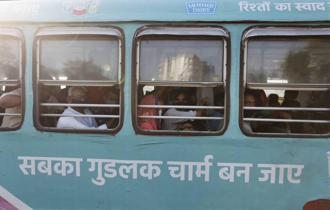 Migrants Gather Outside Lokmanya Tilak Terminus In Mumbai To Return To Their Homes.