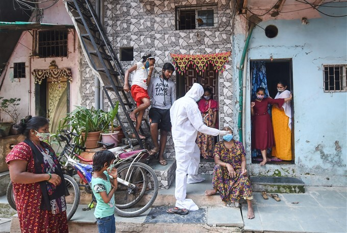 Health Worker Collects COVID-19 Test Sample In Mumbai