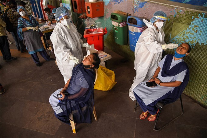 Health Worker Collects Sample For COVID-19 Test Across Mumbai